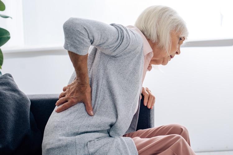 ExcellentCarePharmacy_Arnprior_Ontario_Drive_Thru_back_pain_senior_woman